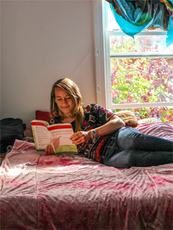 A Cooper studying in their bedroom.