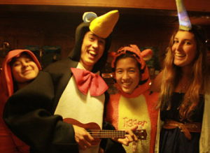 A Cooper playing the ukulele in a penguin suit.